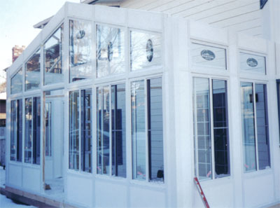 all white aluminum and glass sunroom